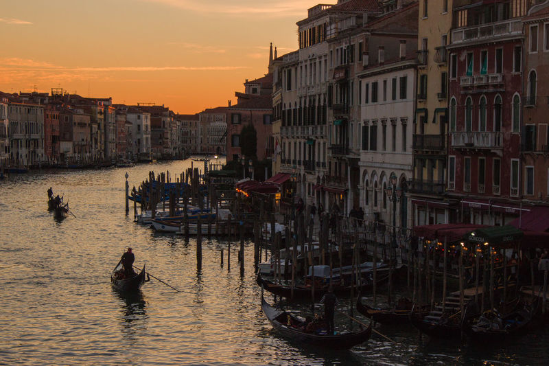 Architecture Boat Building Building Exterior Built Structure Canal City City Life Cloud - Sky Gondola Mode Of Transport Nature Nautical Vessel No People Outdoors Residential Building Residential Structure Rippled Sky Sunset Travel Destinations Venice Water Waterfront Wooden Post