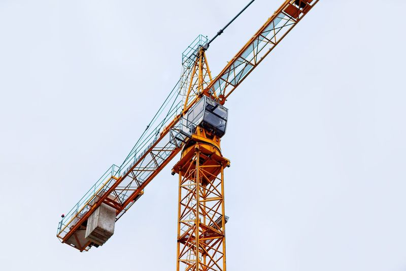 Low Angle View Crane - Construction Machinery Machinery Sky Construction Industry Construction Site Clear Sky Industry Architecture Development Copy Space Tall - High Built Structure Metal Construction Equipment Nature Construction Machinery Day No People Outdoors