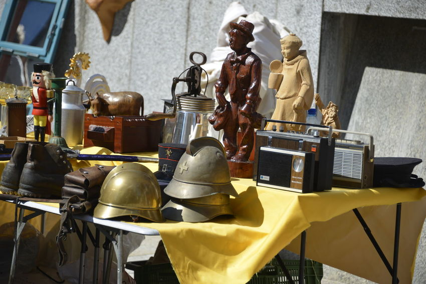 Swiss helmet Art And Craft Belief Close-up Craft Creativity Day Figurine  Flee Market Human Representation Indoors  Male Likeness Metal Musical Instrument No People Religion Representation Sculpture Silver Colored Spirituality Statue Still Life Swiss Helmet Table