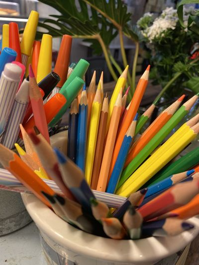Close-up of multi colored pencils in container