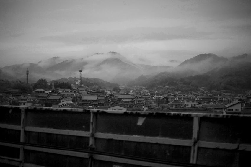 Japan Architecture Building Building Exterior Built Structure City Cloud - Sky Day Environment Fog High Angle View House Mist Mountain Mountain Range Nature No People Outdoors Pollution Residential District Roof Sky TOWNSCAPE
