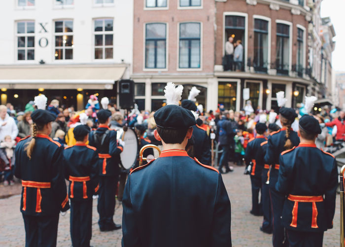 Rear view of marching band on street during festival