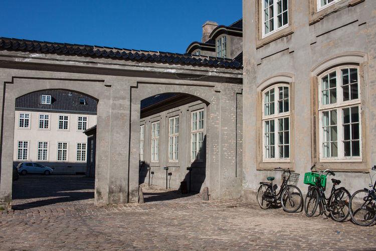 Building Exterior Built Structure Architecture Building Bicycle Window No People Transportation City Day Mode Of Transportation Nature Arch Street Outdoors Land Vehicle Sky Sunlight Residential District History