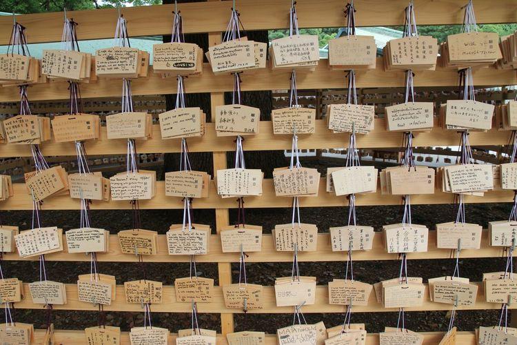Full frame shot of praying blocks hanging outdoors