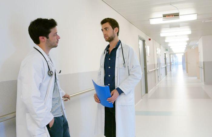Doctors Talking Corridor Hospital Medical