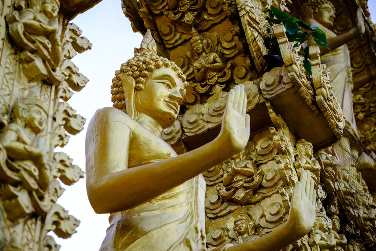 Buddha Gold Thailand Watpaknamjolo Art And Craft Buddhist Temple Built Structure Carving Craft Creativity Gold Colored History Human Representation Low Angle View Religion Representation Sculpture Spirituality The Past