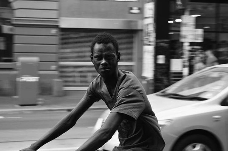 "Soooo this is a story from my photo adventure with Huss on a massively hot day (like 43°C .... or 109.5°F) I had dropped back a little so Huss could take some Architectural Shots and scan the street... Speeding along Brunswick St was this guy on his bike... perfect for my motion blur in this light... I sett the camera... waited a beat, then aimed. No sooner had I got him in focus he Spots me and YELLS! ""HEY!! YOU! WHAT YOU DOING!!"" And he slammed on his breaks stopping right in front of me glaring! Huss had turned around as he yelled, but was further up the street. .... so I smiled and opened the photos on the phone. ""Hahaha, sorry bud. Just taking a photo, trying to work on tracking and alowing the background to blur. Here it is, actually it's a pretty good shot! Oh, wow, love your expression in it!"" He looked at the photo, then looked at me. ""Well brother, at least you got a good one!"" And cracking a huge smile, he held his fist up. We fist bumped... with the l important boom! He shot off on his bike. And I walked back to meet Huss... while he shook his head smiling at me. Street Photography huh? ..... you can't beat it. Blackandwhite Blackandwhitephotography Blackandwhitelove Insta_bw Bnw_society Bnw Bnw_australia Bnw_captures Bnw_city The_lady_bnw MichaelsCamera TheCreatorClass Communityfirst Ig_community Momentsofmelbourne Streetlife_mag EyeEm Justgoshoot Refla5h0367bnwstreet"