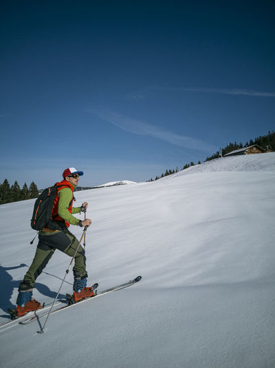 Full length of man skiing on snow covered land