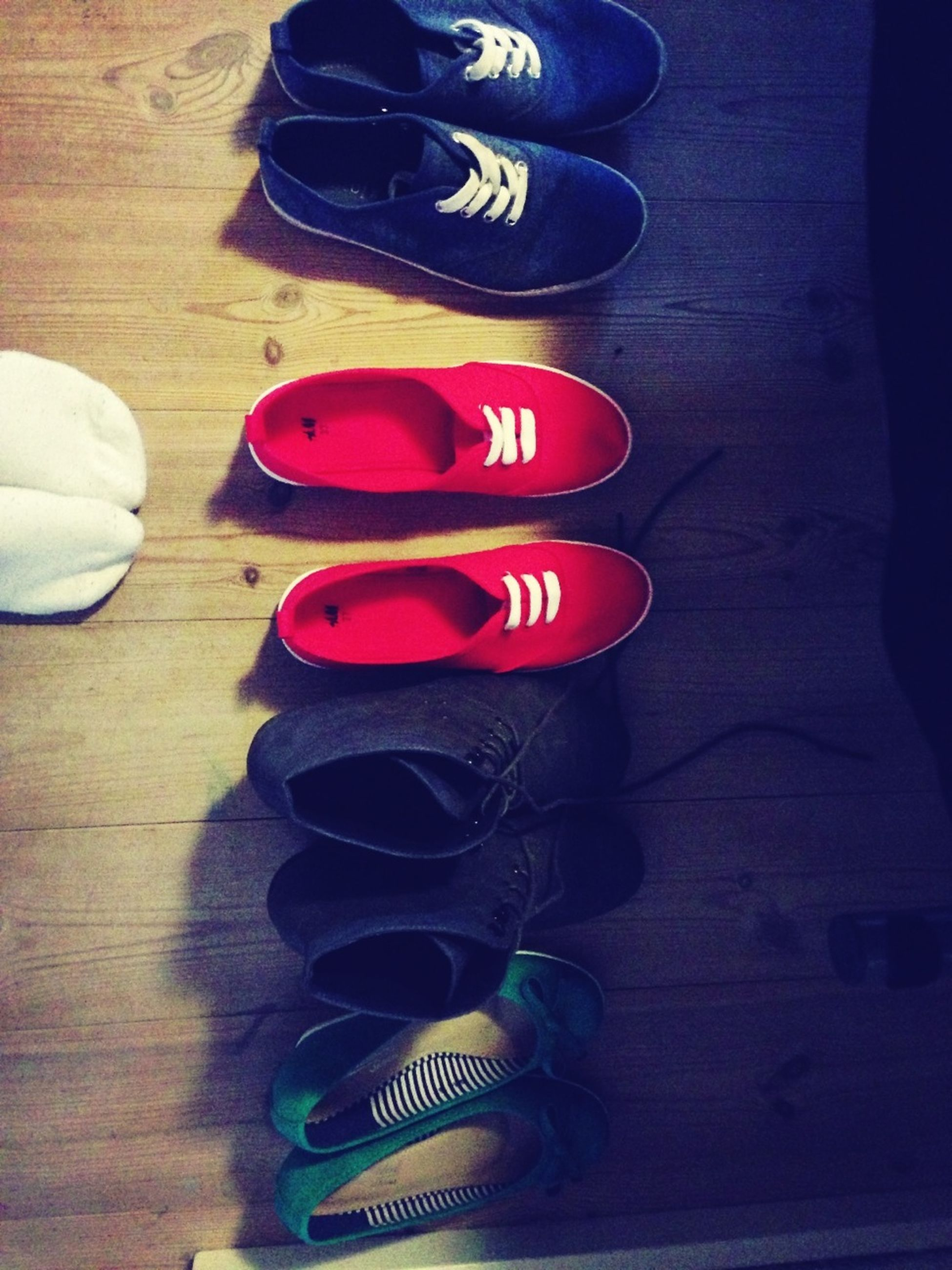indoors, still life, high angle view, shoe, table, wood - material, footwear, variation, pair, close-up, arrangement, large group of objects, red, flooring, floor, choice, in a row, no people, stack, absence