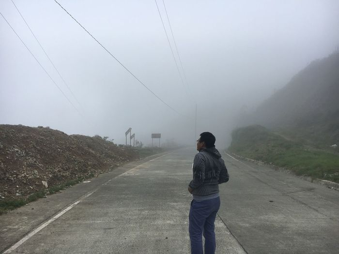 A man out on a foggy day at Banaue, Ifugao Nowhere Speculative Forward Focus Slacks Cotton Slacks The Way Forward Foggy Road Misty Road Foggy Weather Mist Mountain Landscape Beauty In Nature Lost In The Landscape This Is Masculinity