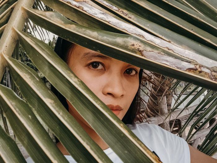 Close-up portrait of girl peeking