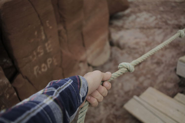High angle view of man holding rope