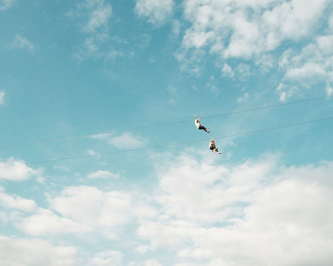 sky zipline EyeEm Selects Flying Mid-air Cloud - Sky Bird Sky Freedom Low Angle View Outdoors Airplane Airshow Motion Day