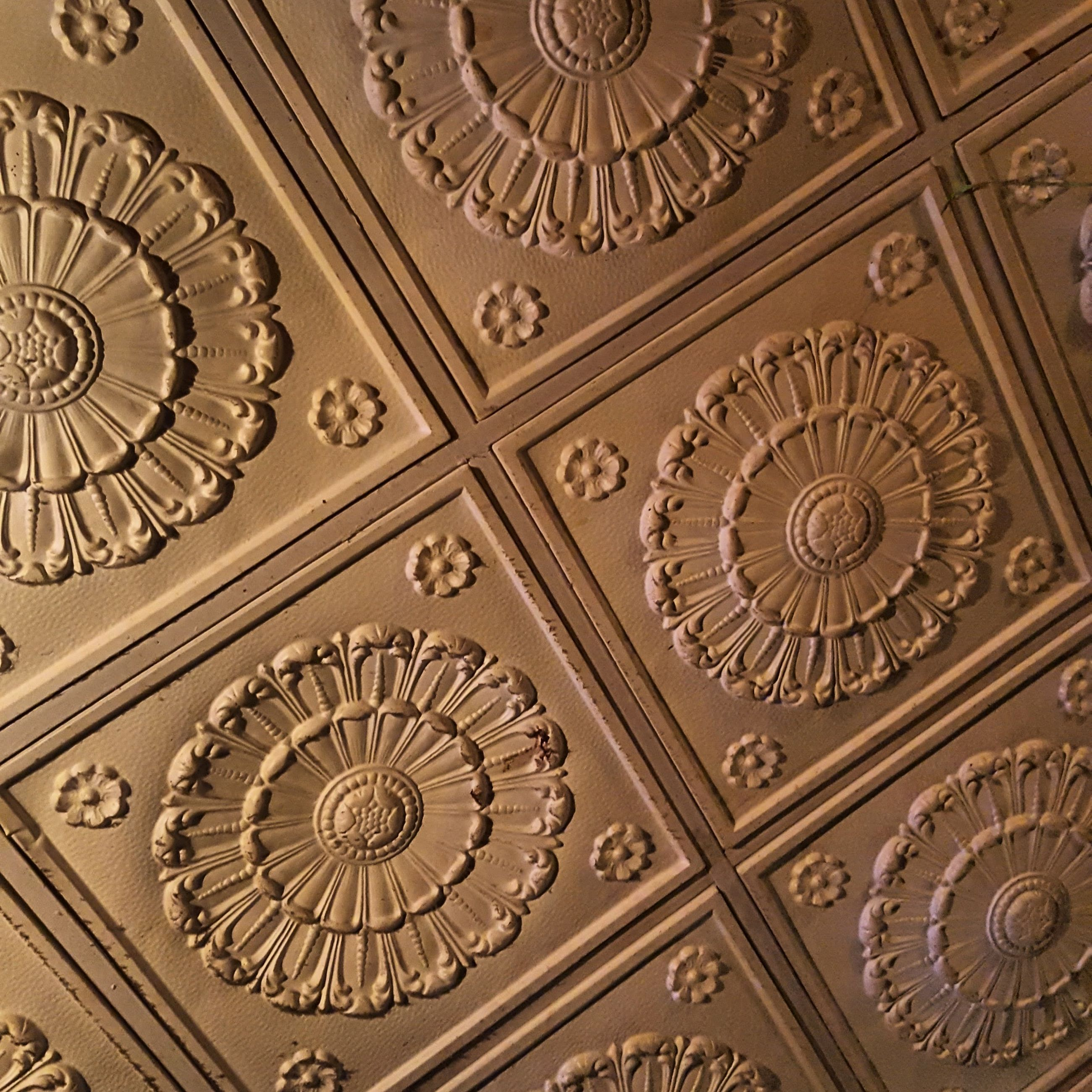 art and craft, indoors, ornate, design, art, creativity, pattern, carving - craft product, ceiling, full frame, close-up, architecture, backgrounds, gold colored, built structure, low angle view, human representation, circle, floral pattern, carving