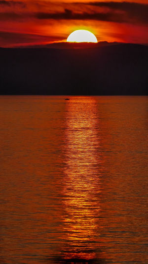 Sunset Sky Sea Beauty In Nature Scenics - Nature Sun Orange Color Water Tranquility Horizon Over Water Cloud - Sky Horizon Tranquil Scene Nature No People Waterfront Sunlight Reflection Idyllic