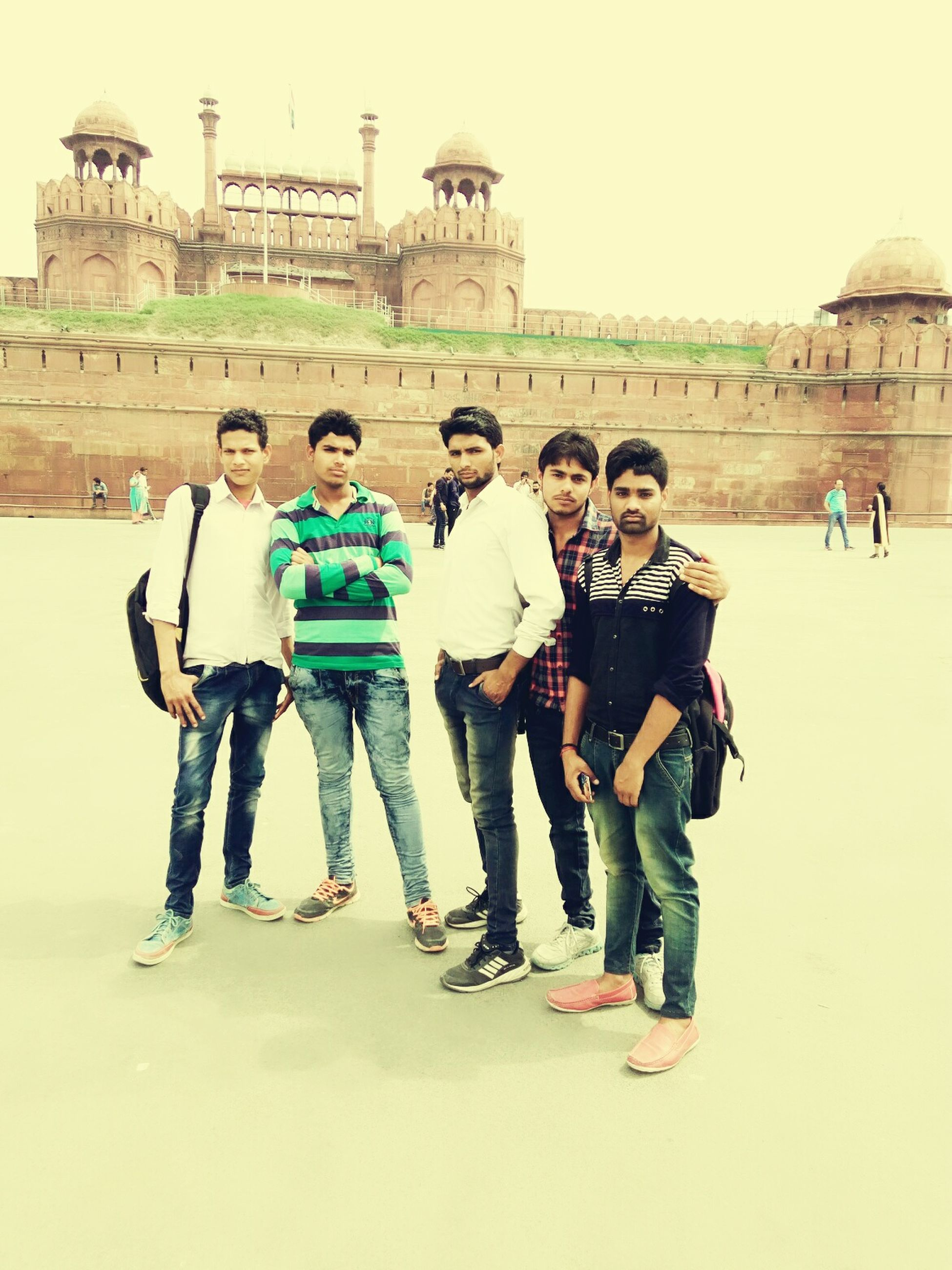 lifestyles, leisure activity, full length, casual clothing, togetherness, happiness, bonding, person, love, standing, enjoyment, large group of people, boys, friendship, fun, childhood, front view, built structure, portrait