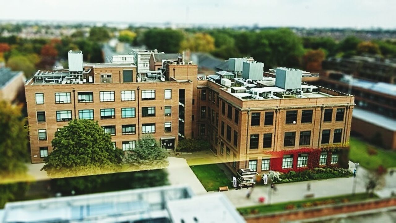architecture, building exterior, built structure, day, high angle view, tree, residential building, city, outdoors, no people, tilt-shift, nature, sky