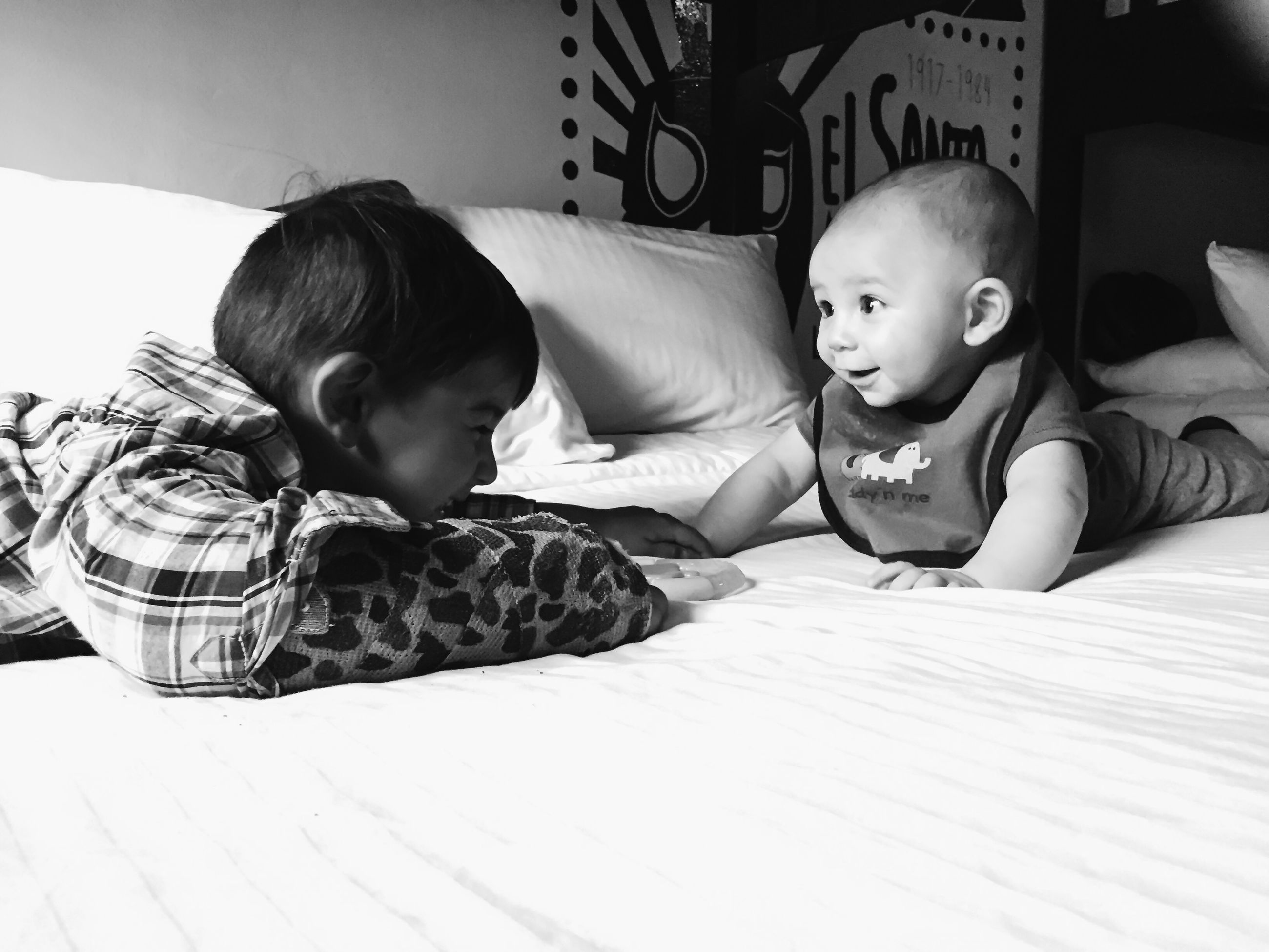childhood, person, innocence, elementary age, boys, indoors, cute, lifestyles, leisure activity, casual clothing, togetherness, baby, relaxation, bonding, girls, toddler, babyhood
