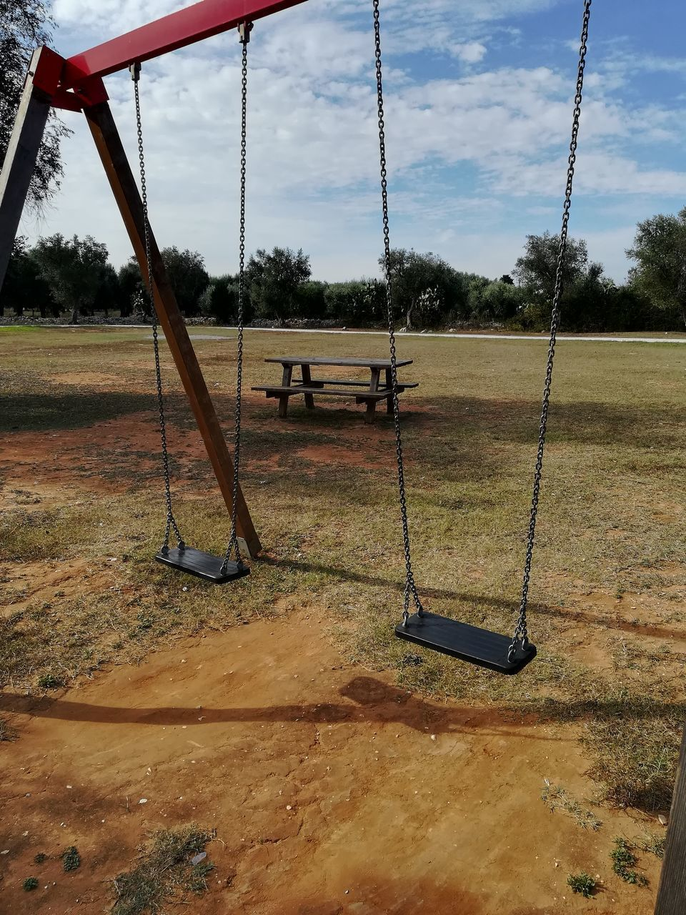 playground, swing, tree, plant, outdoor play equipment, nature, day, grass, empty, sky, cloud - sky, park, childhood, field, absence, park - man made space, land, hanging, outdoors, rope swing, jungle gym