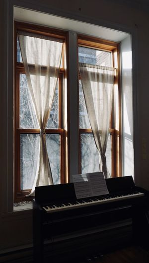 Piano by window at home