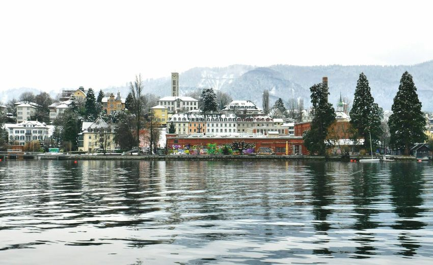 Lake Zurich in pastel | Lake View in Pastel Colours Lake Zürich Switzerland_2016 Cold Day on the Lake Boat Trip Winter Wonderland Taking Photos Calm Water Grey Day Building Exterior Buildings Nature_collection Winter Tranquility Painting in Zürich, Switzerland