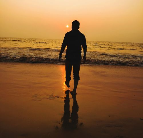 alone.. Sunset Silhouette Beach Sea Reflection Wet Water Only Men Vacations Walking Men One Person Nature Summer One Man Only