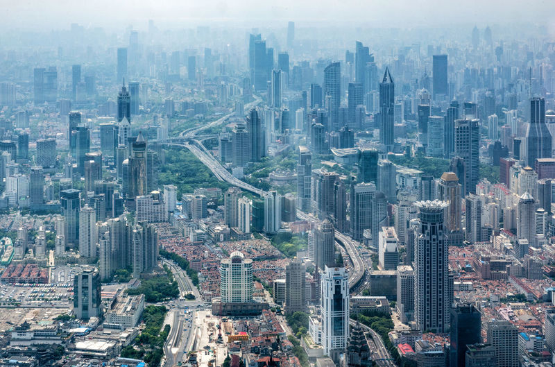 Shanghai Shanghai Tower Skyline Aerial View Architecture Building Exterior City City Life Cityscape Crowded Day Downtown Downtown District Fog Modern Outdoors People Shanghai Skyline  Skyscraper Tower Travel Destinations Urban Skyline