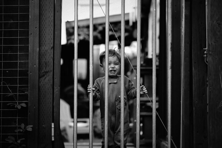 Gate Jail Nap Time Patio Behind Bars Black And White Childhood Close-up Crying Crying Child Day Indoors  One Person Outdoors People Playpen Sad Time Out Toddler  Trapped