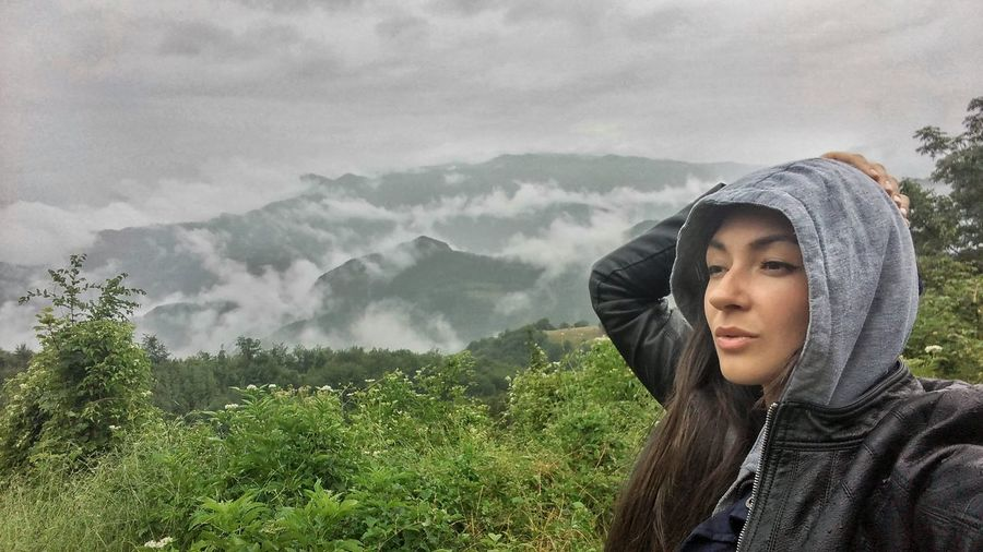 Selfie photo of travelling woman. Lake view.Rainy weather. Adult Adults Only Day EyeEm Best Edits Foggy Green Color Hiking Lake View Lifestyles Mountain Mountain Range Nature One Person Outdoors People Rainy Real People Selfie Selfies Travel Traveling Tree Women Young Adult Young Women
