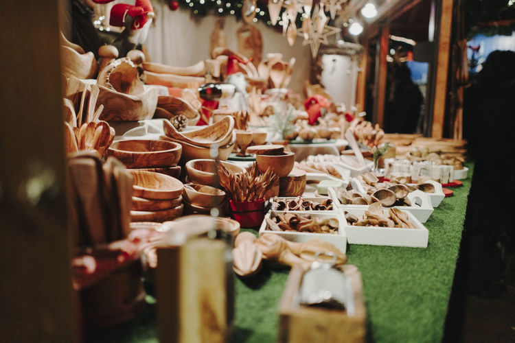 Christmas Market Germany Selective Focus Large Group Of Objects Choice Variation Incidental People Abundance Indoors  Arrangement Retail  Freshness Collection Market For Sale Business Food And Drink Table Food Sale Group Of People Market Stall Christmas Christmas Market Christmas Decoration Christmas Lights