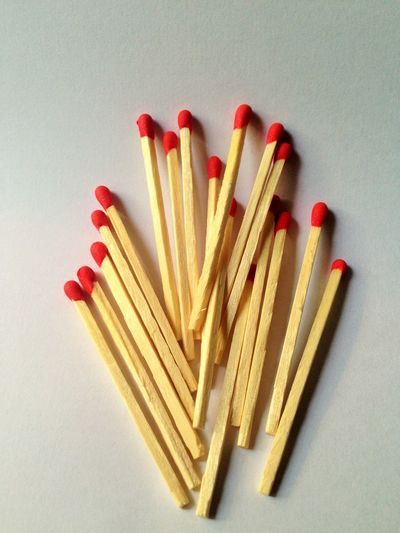 Close-Up Of Matchsticks On White Background