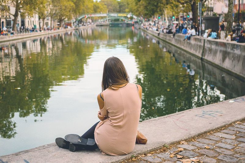 Vue sur la ville #Pause #Paris #canal Water Full Length Tree Sitting Childhood Rear View Child Lake Women Reflection Canal
