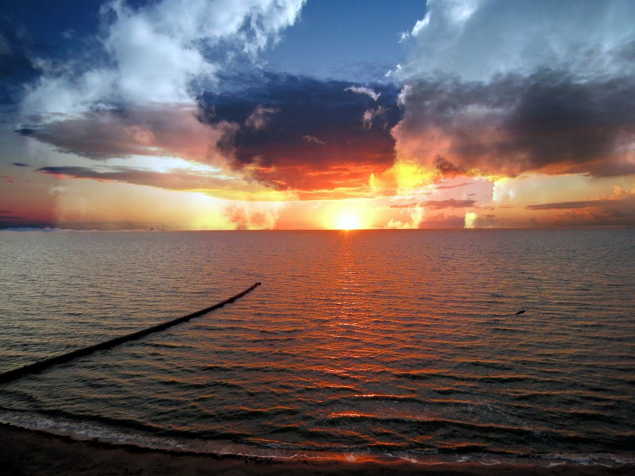 sunset, sea, orange color, scenics, beauty in nature, water, sky, cloud - sky, tranquility, tranquil scene, nature, horizon over water, sun, silhouette, idyllic, no people, outdoors, sunlight, day