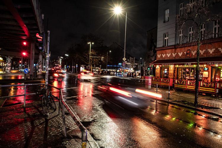 Light trails on city street during rainy season at night
