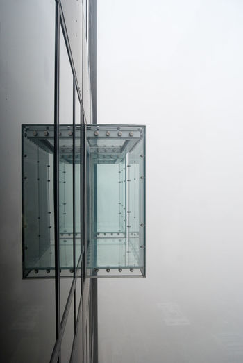 Glass balcony at a skyscraper on a foggy day
