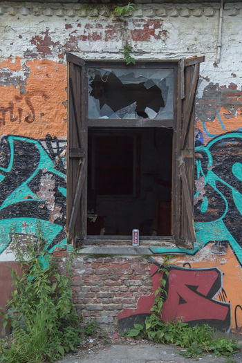 Abandoned Architecture Bad Condition Brick Wall Building Exterior Built Structure Close-up Damaged Day Door Doorway Entrance Entry Graffiti House No People Open Door Outdoors Plant Weathered Window Doel Belgium