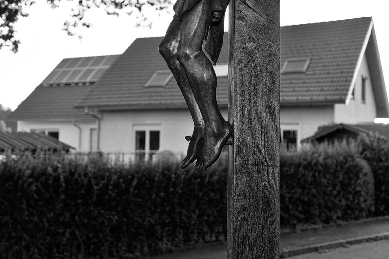 Statue of tree outside house