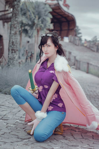 Tashigi cosplay from one pice Cosplay One Piece Beautiful Woman Beauty Casual Clothing Clothing Cosplayer Day Fashion Front View Full Length Hairstyle Leisure Activity Lifestyles One Person One Piece Cosplay Outdoors Portrait Real People Sitting Sword Tashigi Women Young Adult Young Women