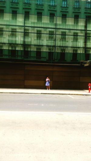 Woman walking on road in city