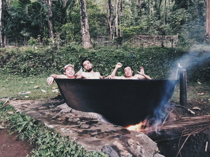 Men Relaxing In Hot Tub