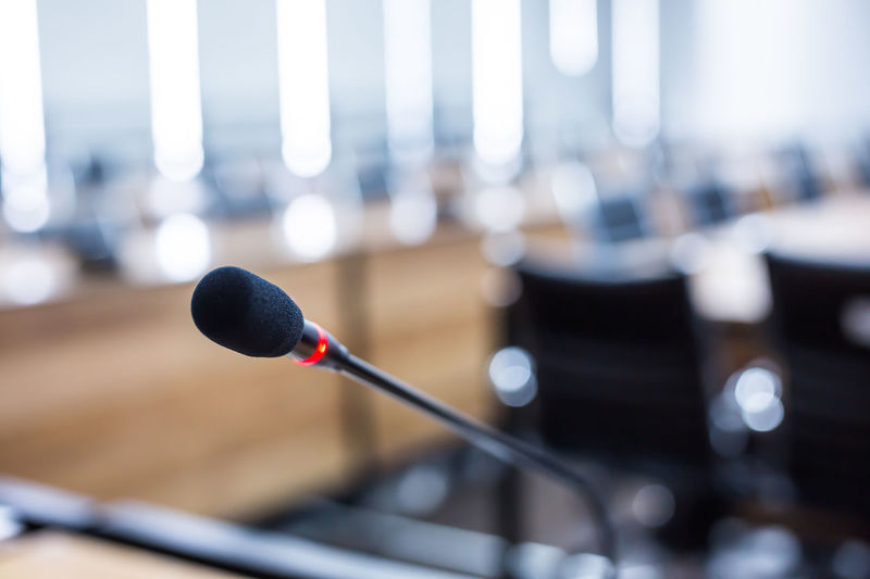 Authority Black Color Business Close-up Communication Conference - Event Day Focus On Foreground Indoors  Input Device Metal Microphone Nature No People Politics Preparation  Red Selective Focus Stage Sunlight