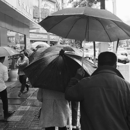 EyeEm Diversity Iphonephotography Mobilephotography Day The Human Condition Large Group Of People Outdoors City Street Street Men City Rainy Days Rear View Blackandwhite Monochrome