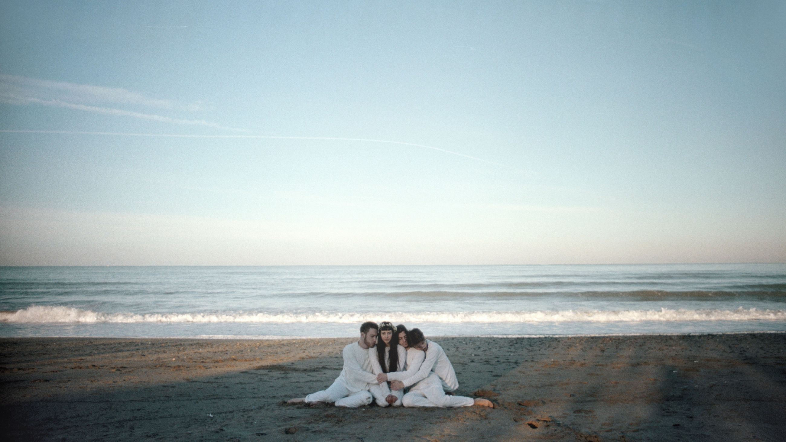 sea, water, horizon, beach, horizon over water, land, sky, beauty in nature, women, sitting, two people, scenics - nature, nature, togetherness, people, idyllic, tranquility, couple - relationship, relaxation
