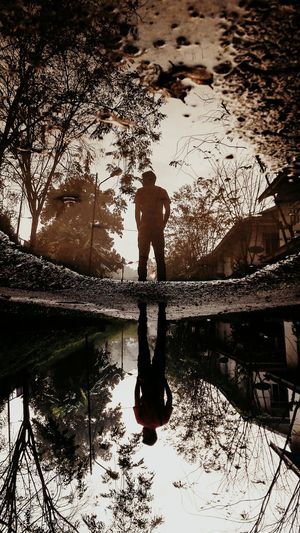 Up side down Reflection Water Sky Nature Sunset Leisure Activity Outdoors Lifestyles Cloud - Sky Silhouette Day Real People Beauty In Nature Adults Only People Postthepeople Imaginatones EmNewHere Leiblingsteil Shiluette Playwithshadows Light And Shadows Shadow