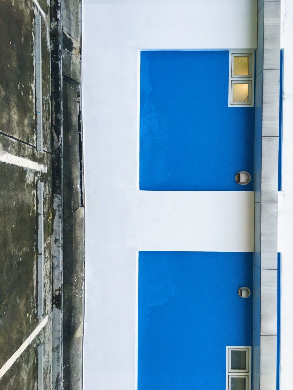 blue, architecture, built structure, building exterior, no people, wall - building feature, day, white color, building, window, outdoors, door, entrance, metal, sky, protection, glass - material, safety, security, close-up