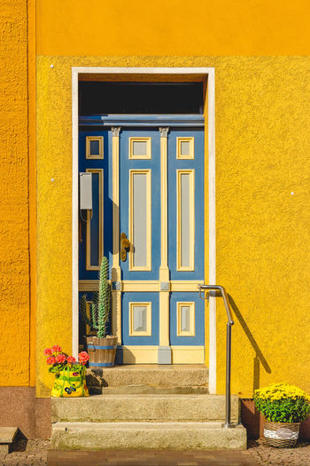 Closed door of yellow building