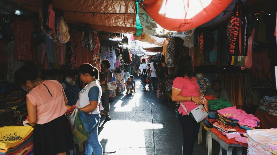 An alley less busy. Adults OnlyIlluminated Real People People Adult Day Outdoors Alley Way Busystranger Busy Place Vendor
