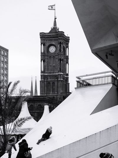 Building Exterior Built Structure Architecture Religion Winter Place Of Worship Spirituality Cold Temperature Day Outdoors Snow Travel Destinations Sky City Real People One Person Capture Berlin Berlin Streetphotography Blackandwhite Monochrome Alexanderplatz Candid