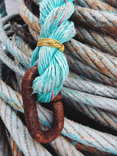 Close-Up Of Rusty Metal Attached Rope
