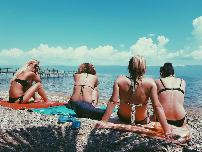 EyeEm Best Shots EyeEm Gallery Eyeemphotography EyeEm Selects Way Of Life Albania Ways Of Seeing Sunlight And Shadow Friendship Young Women Water Beach Togetherness Sitting Sea Swimming Pool Summer Women Beach Holiday #urbanana: The Urban Playground My Best Travel Photo 50 Ways Of Seeing: Gratitude This Is Natural Beauty Human Connection It's About The Journey International Women's Day 2019